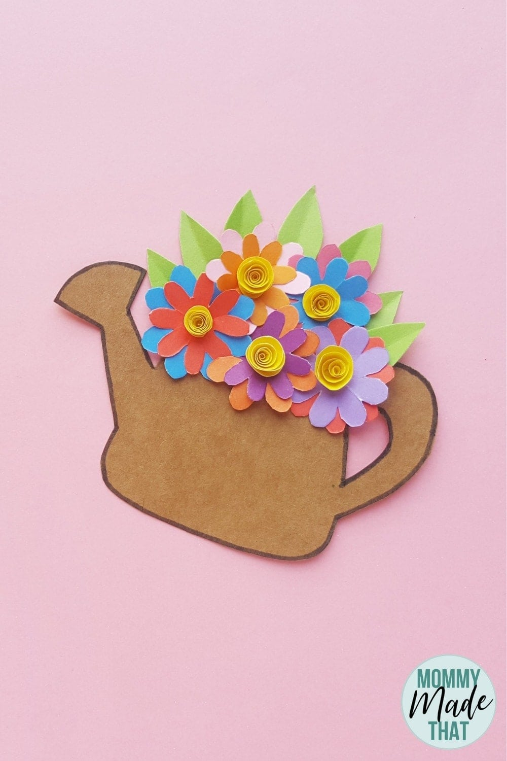 Adorable spring time kids craft. This fun and simple to make paper flower craft looks beautiful when finished. Comes with a free printable paper flower template you can download too!