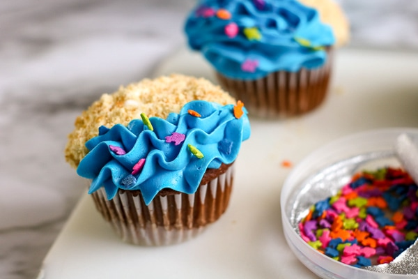 Beach cupcakes with sand and waves and fish sprinkles