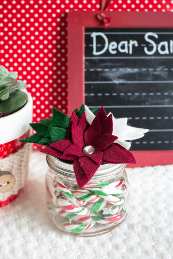 Christmas mason jar gift with poinsettia flower on top
