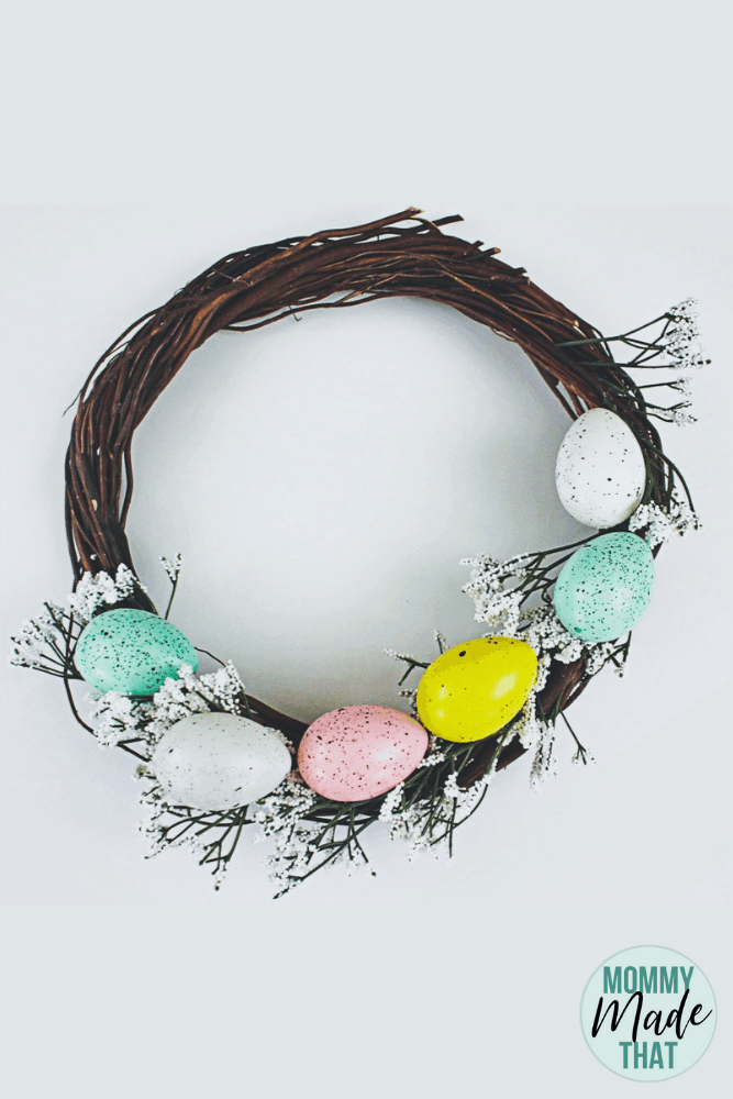 DIY Easter Wreath from Dollar Store Supplies. Make this easy Easter wreath using dollar tree eggs and flowers! Makes for a fantastic easter decoration!