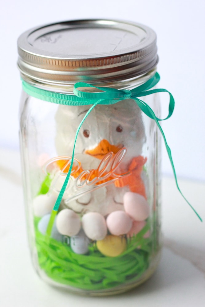 """Chocolate Easter bunny """"chick"""" mason jar display. Would make a wonderful Easter Gift."""
