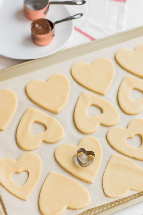 cutting hearts out of sweetheart cookies