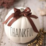 """cricut thanksgiving pumpkin craft, creamy pumpking with the word """"thankful"""" printed on it"""
