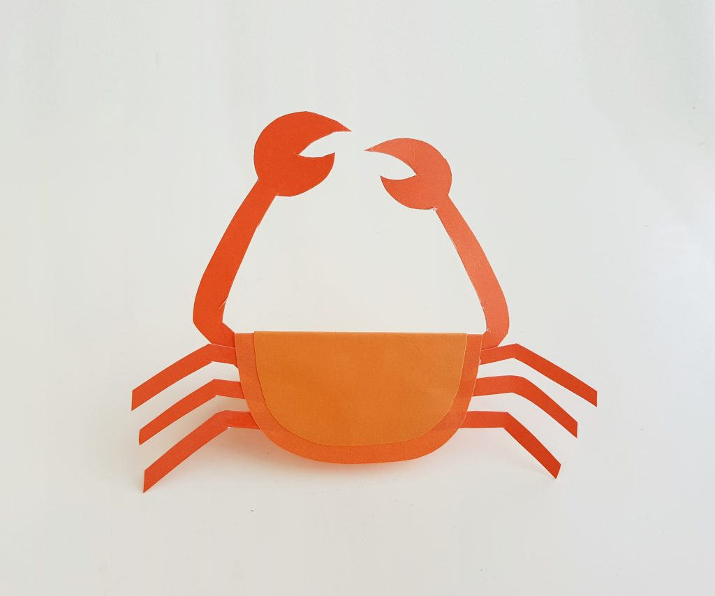 step six of making a paper crab for kids