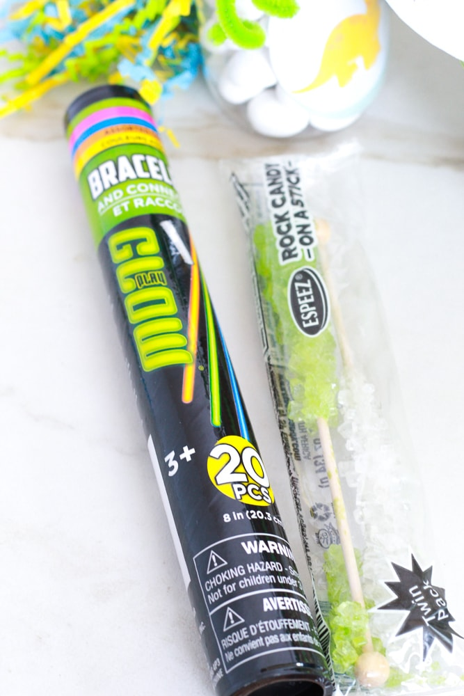 glow sticks and rock candy for dinosaur easter themed basket fillers