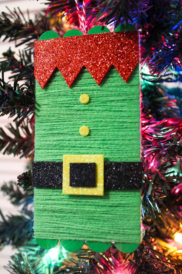 Elf craft ornament for kids hanging on a Christmas tree