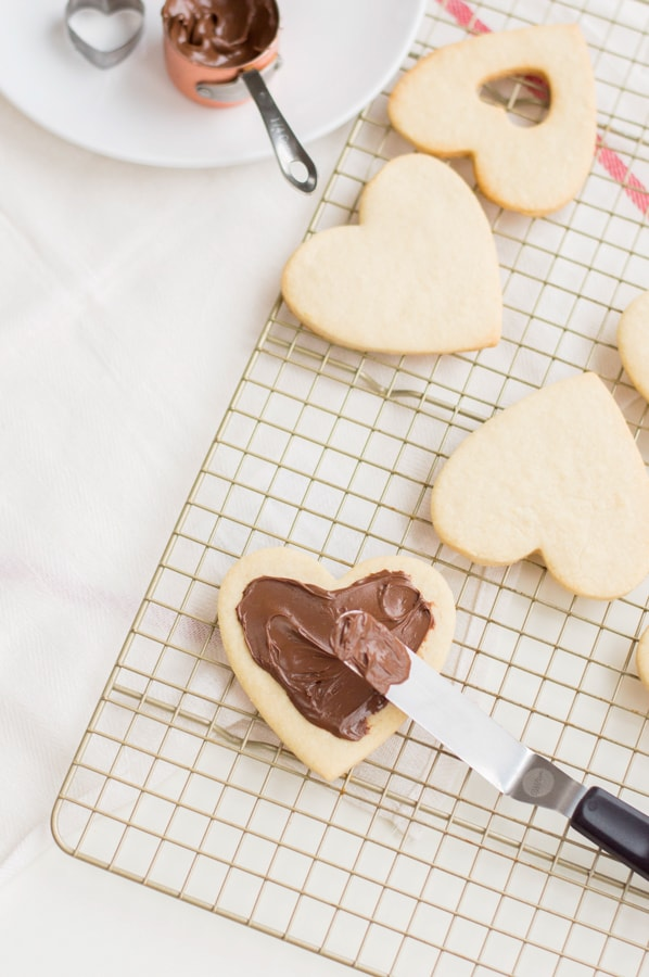 sweet heart cookies being filled with nutella