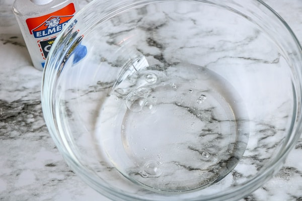 clear glue in a mixing bowl to make fall slime
