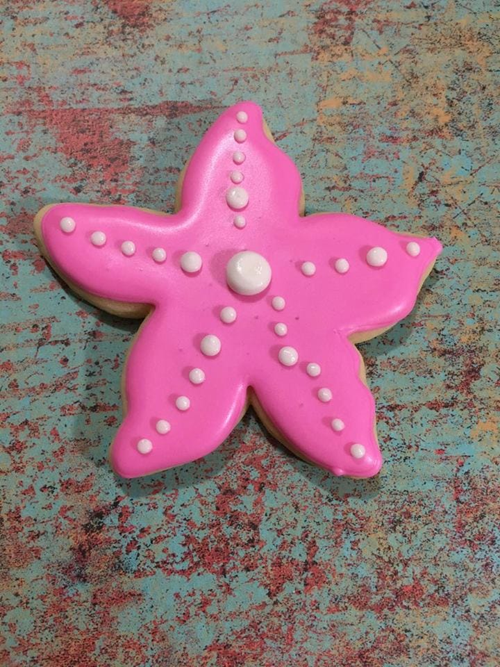 3rd step in icing starfish with royal icing for mermaid themed party.