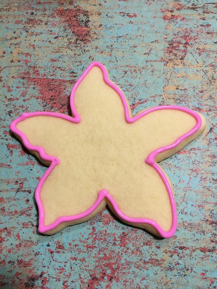 First step in making starfish cookies for mermaid themed party.
