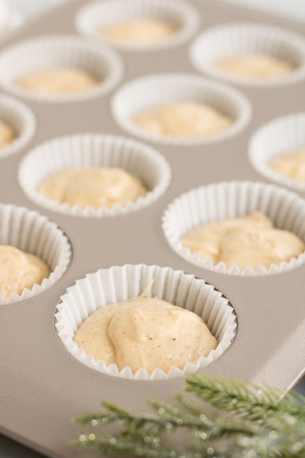 eggnog cupcake batter in cupcake pan