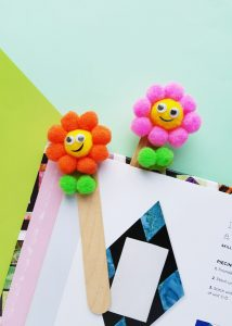 making flower bookmarks with pom poms and popsicle sticks