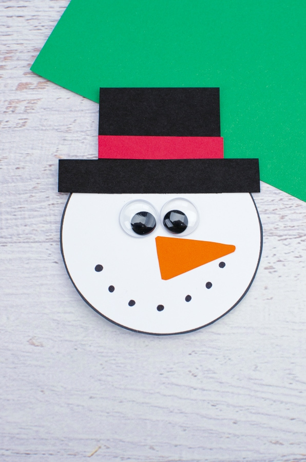 making snowman spinner craft snowmans face