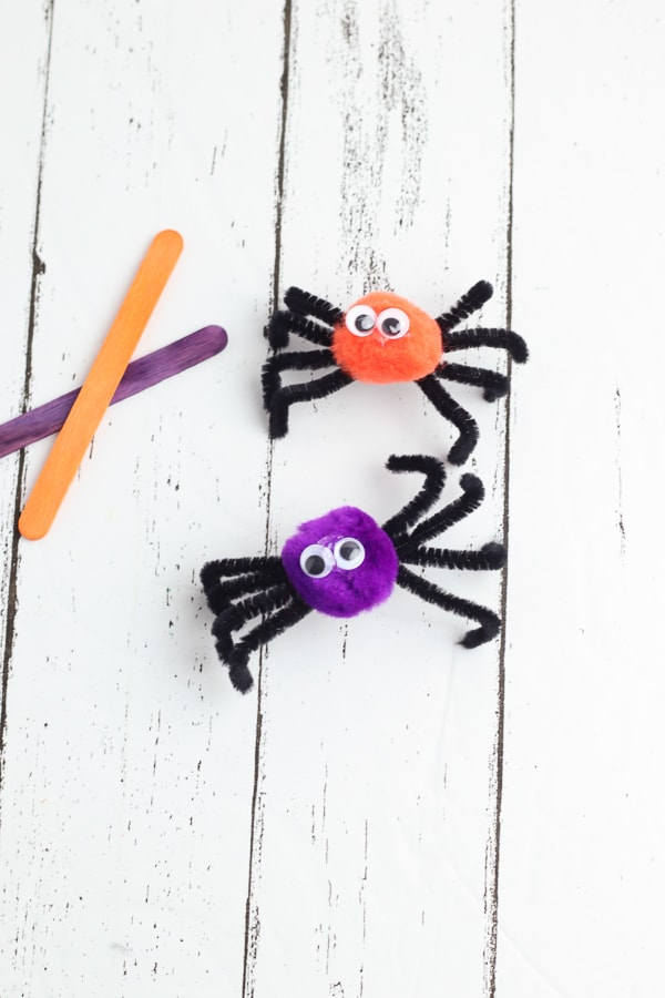 adding googly eyes to spider puppets