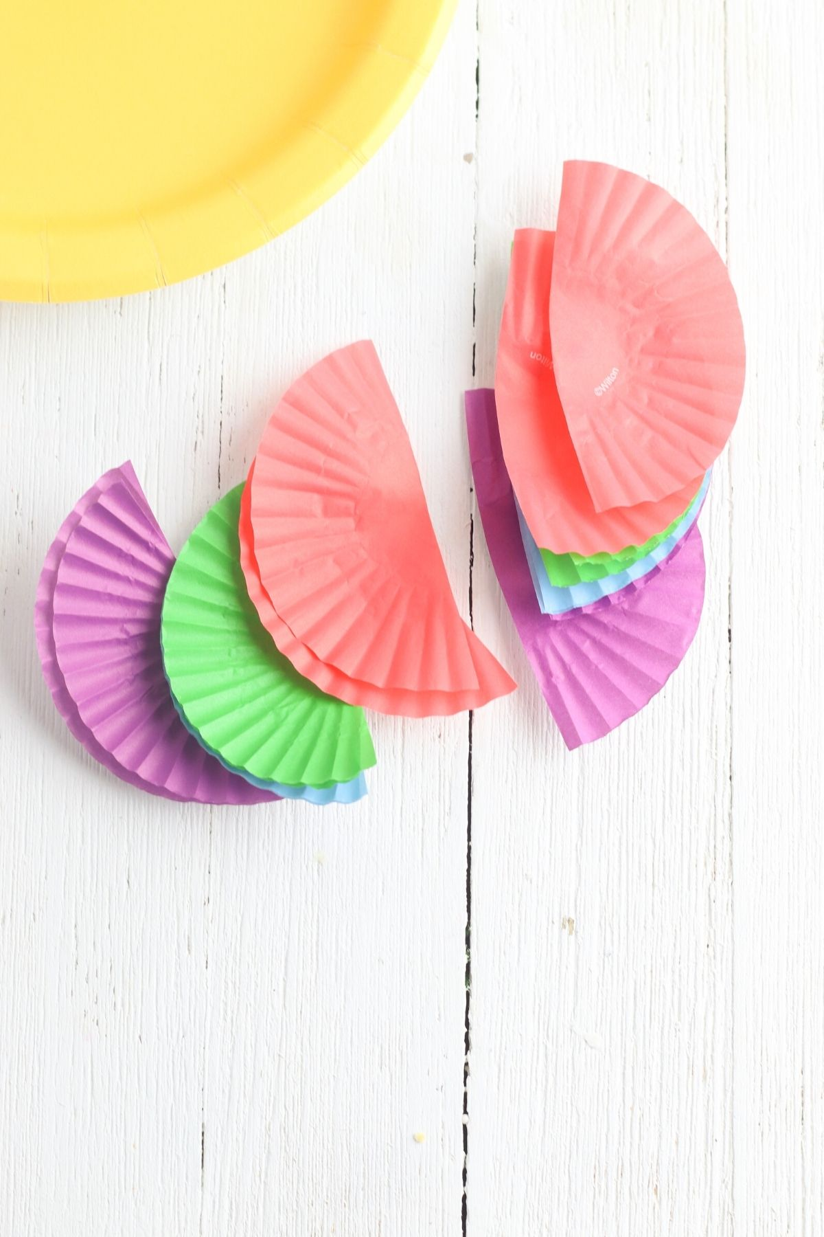 Using cupcake liners to make fish scales for a paper plate fish craft