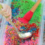 rainbow rice dyed with food coloring for sensory bin